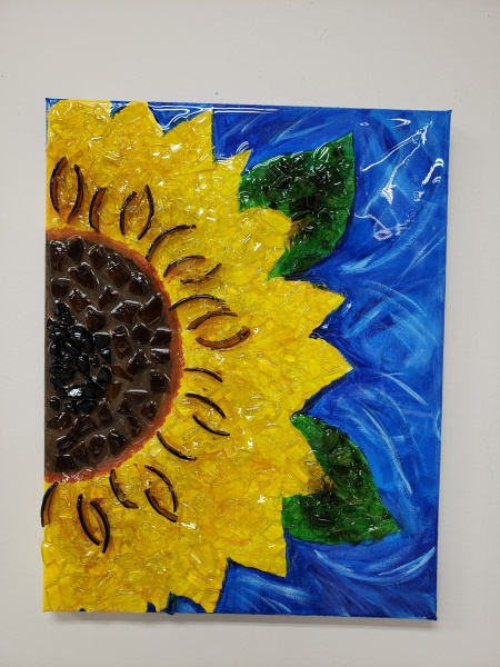 Sunflower half with shattered glass