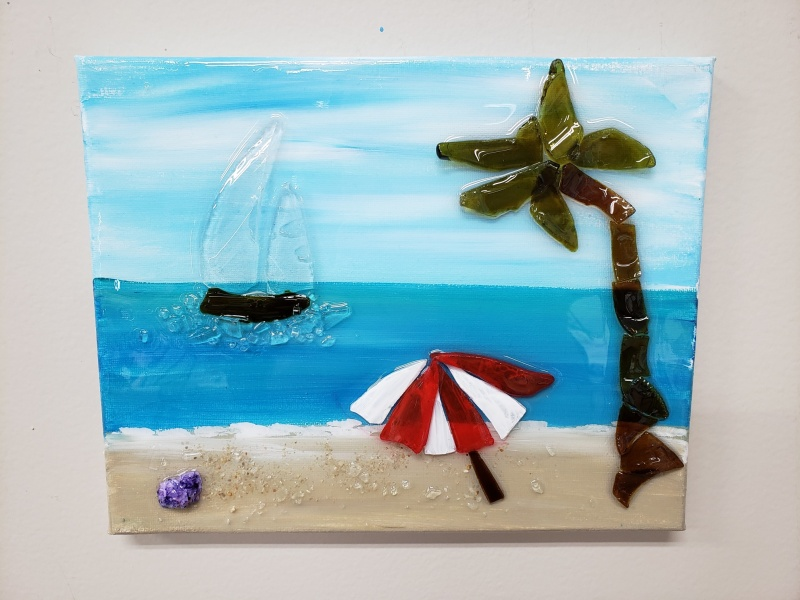 Beach scene with umbrella made with shattered glass