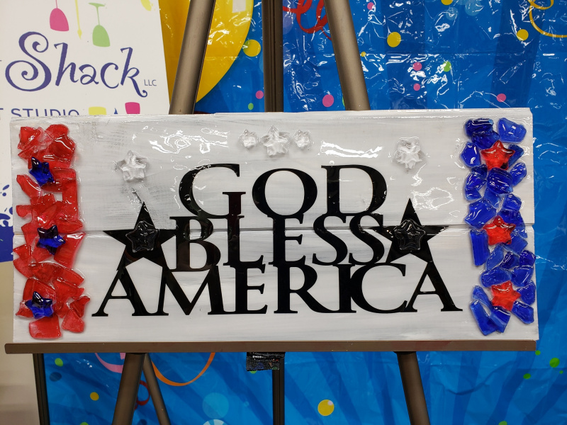 God Bless America with shattered glass