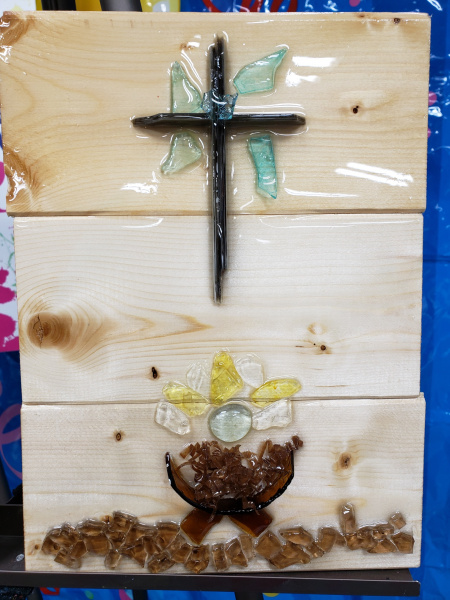 Manger and cross  with shattered glass