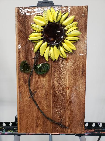 Sunflower (beer bottom, barbed wire, bottle caps, wine bottle leaves) shattered art