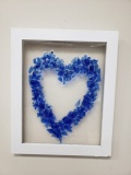 Blue heart on a picture frame