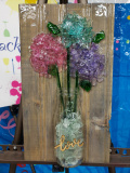 Flowers in a Love vase with shattered glass
