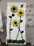 Black-eyed susans with barbed wire, bottle caps and shattered glass